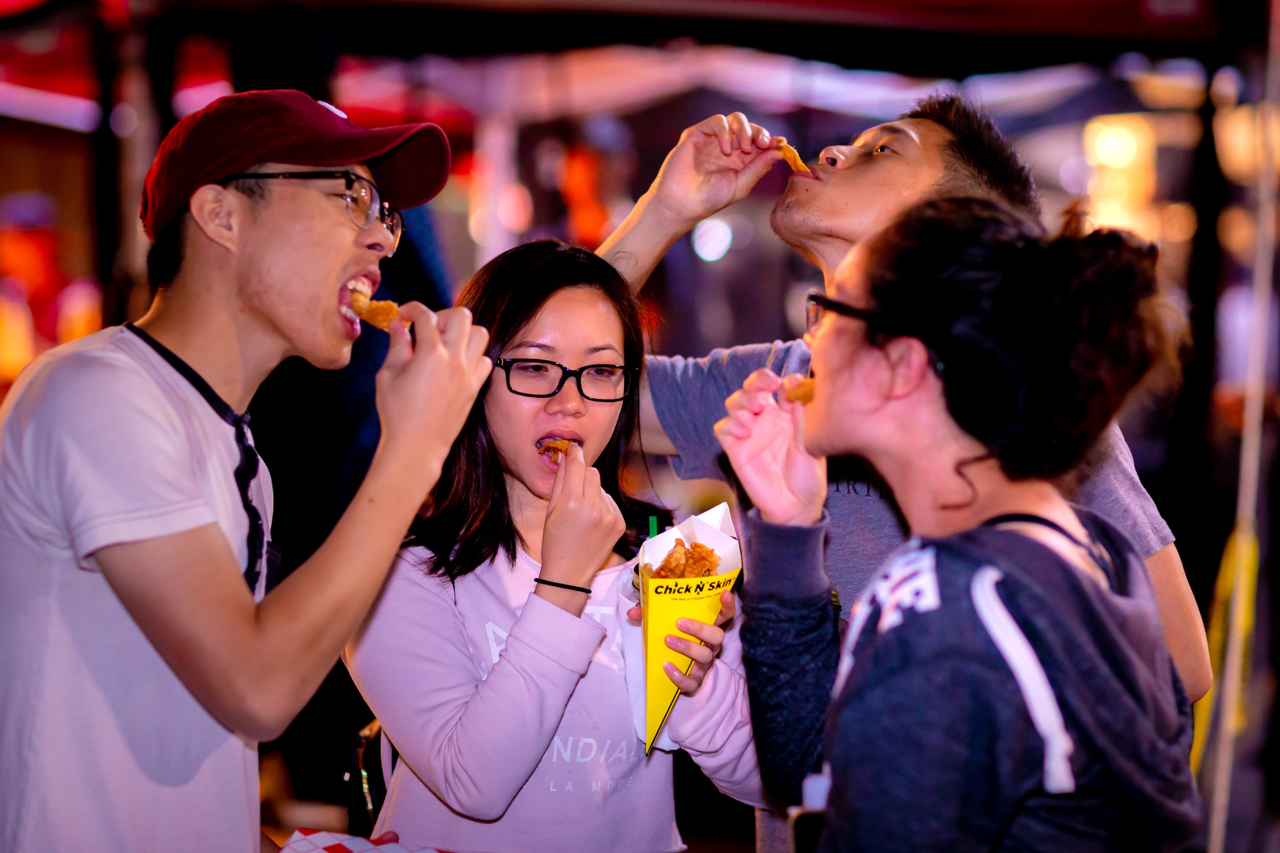 Trying flavored fried chicken skins from vendor  Chick N' Skin . Photo by John Truong.