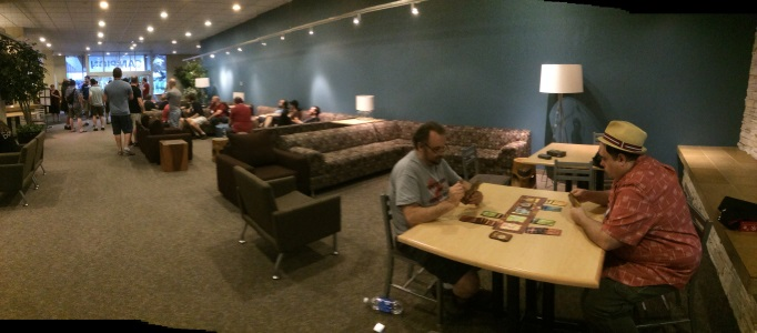 Initial meetings and friendlies in the lobby of the dorm. A game of Lost Cities in the fore.