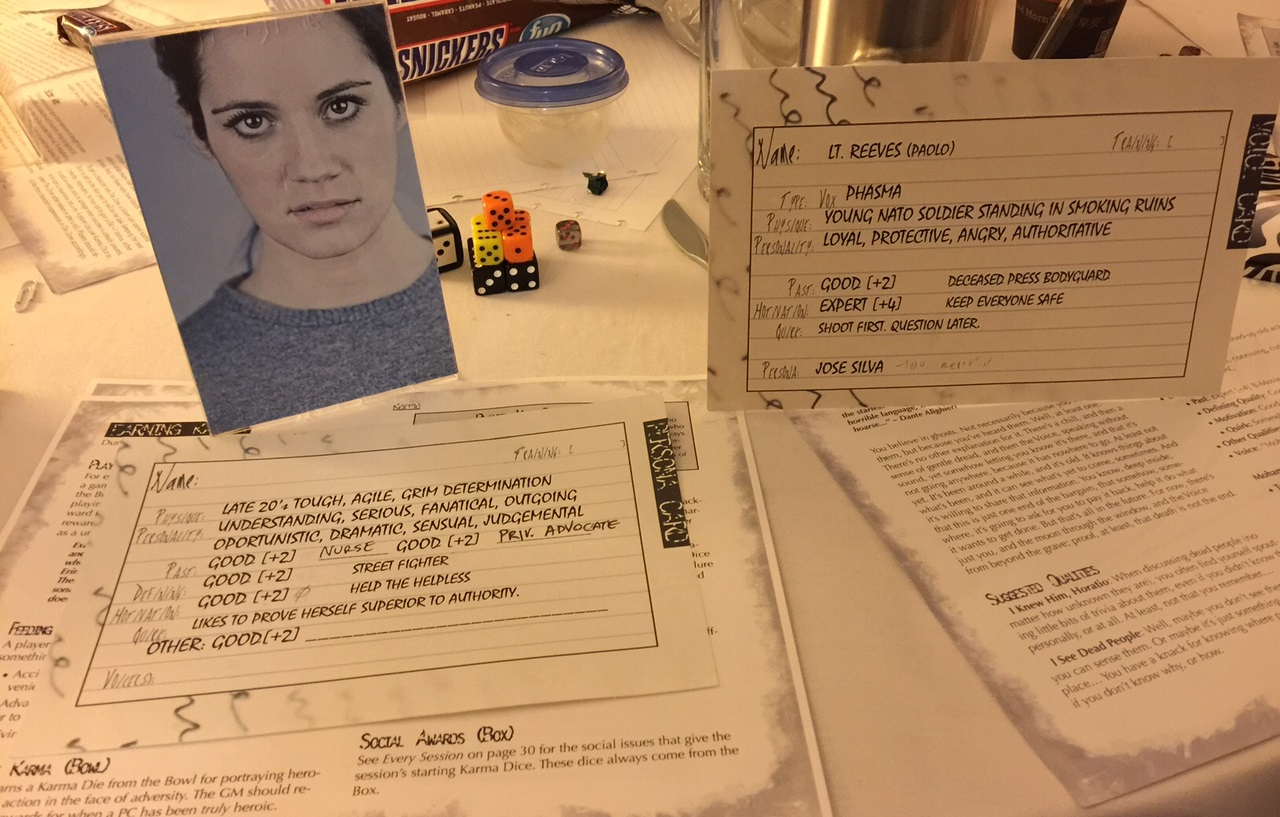 On the left, a picture, and character record with blanks that would slowly get filled out. On the right, a ghost that whispers in the ear of another player.