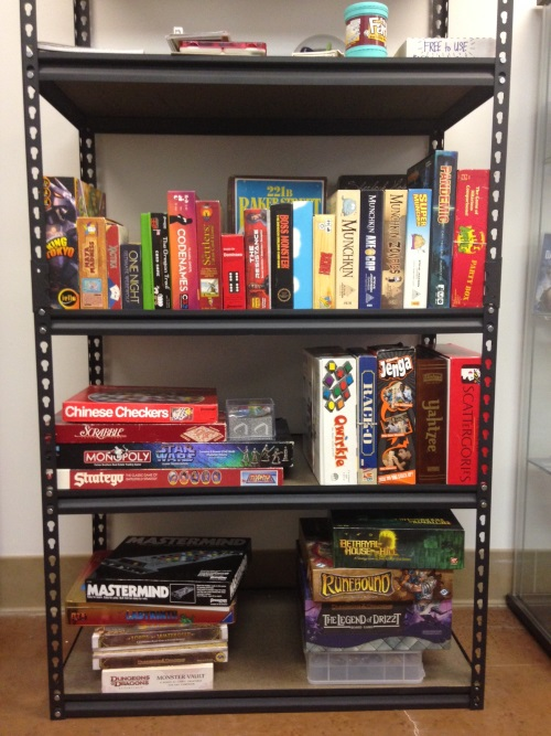 A growing shelf of free-to-play games; I've been slowly contributing to it as I've visited various thrift stores in the area: Qwirkle, Rack-O, Jenga, Maya Madness, Apples to Apples, Carcassone...