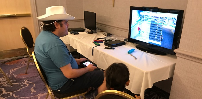 Mario Kart action in the little video game room.