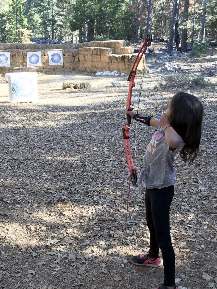 Archery with an adult bow the first day.