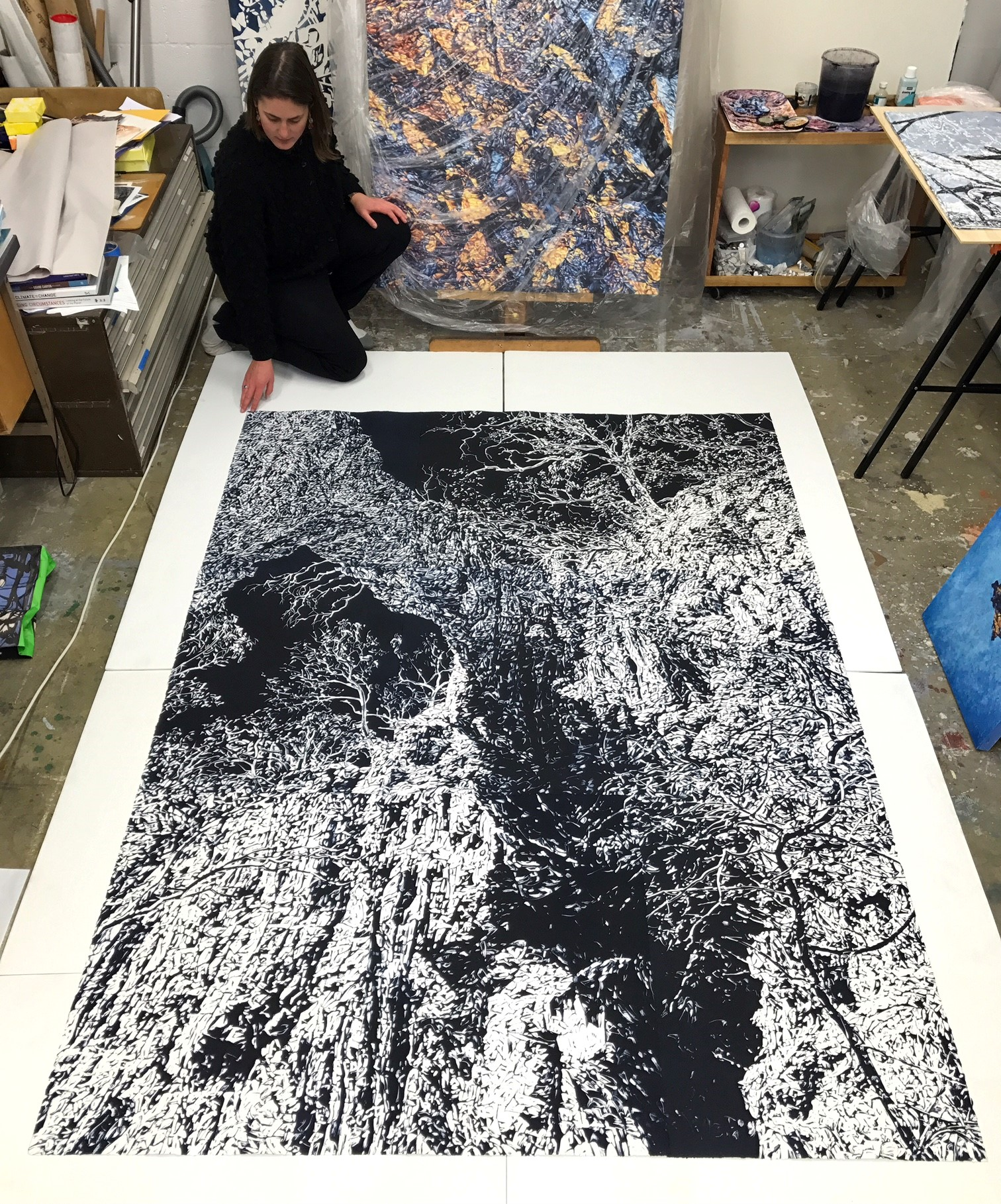 Annika Romeyn in her ANCA Dickson studio with her monotype work 'Chasm 3', 2017