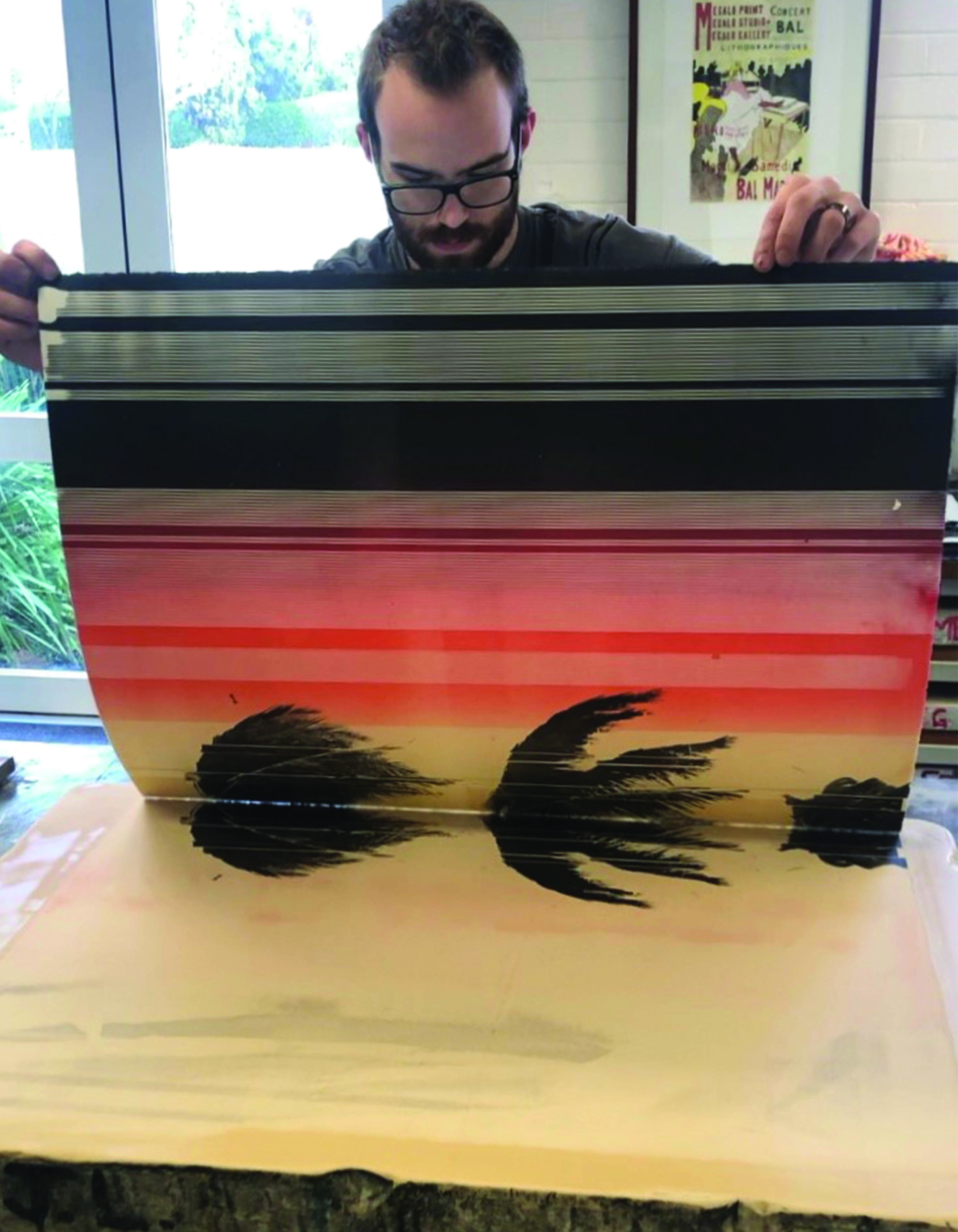 Pulling the final multi-stone print - images created using screen print on stone method