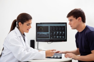 Dentist discussing report