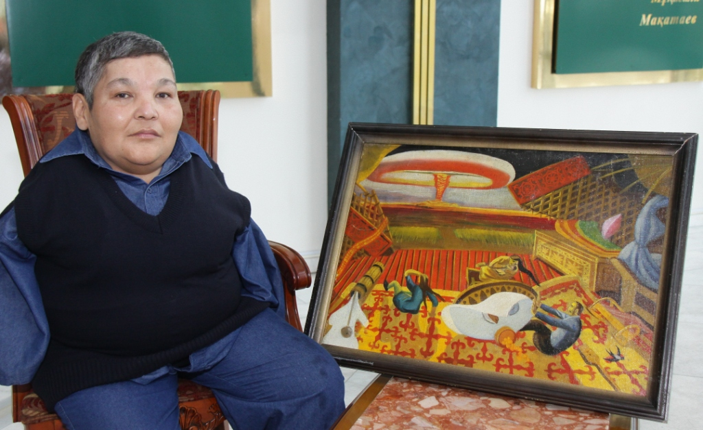 Karipbek with one of his paintings.