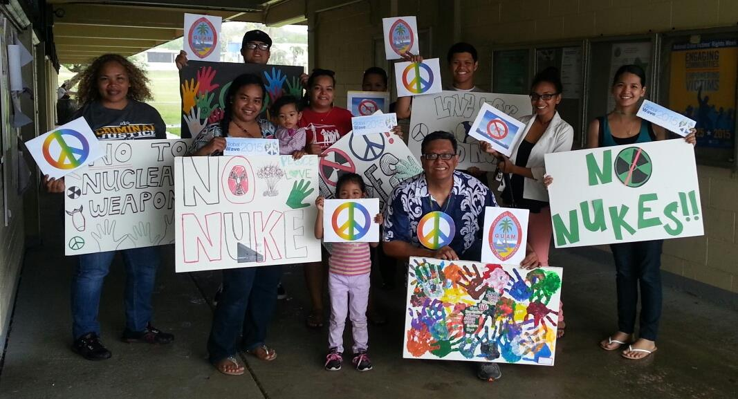 Rain didn't stop the Guam Global Wave 2015 from taking place at 1:00pm, Chamorro Standard Time, on April 27, 2015. We just moved it under the cover of the buildings. Biba Guam for peace and waving goodbye to nuclear weapons!