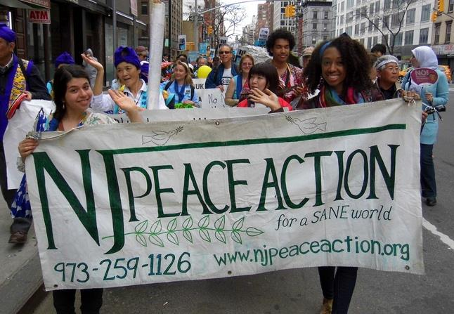 Peace& Planet Rally participants wave goodbye to nuclear weapons, Manhattan, NY.