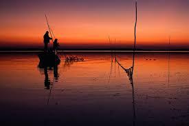 Mila 23 - pescari în liniștea majestuoasă a Deltei Dunării.