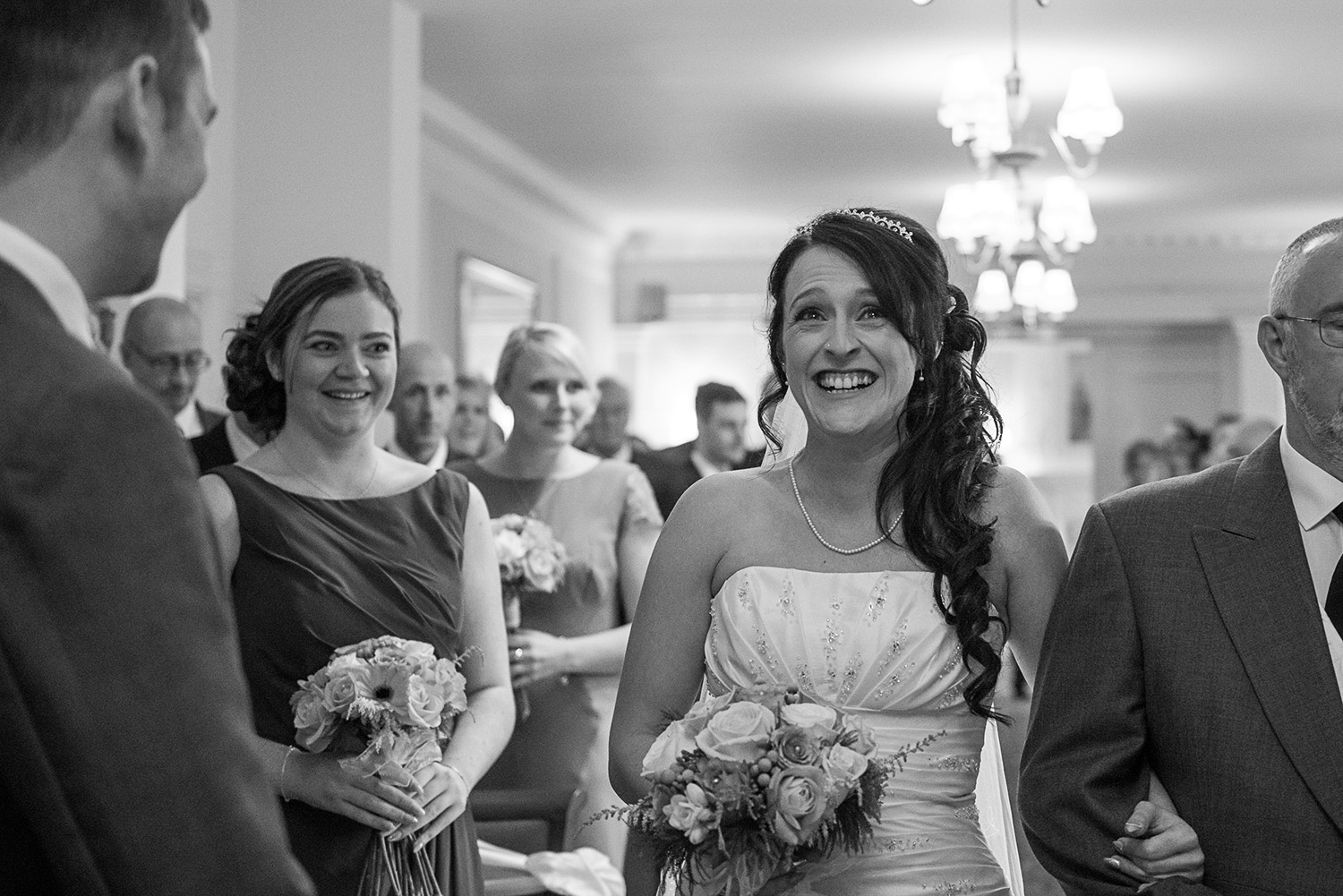 Copy of bride walking down the aisle at Hoyle Court in Baildon