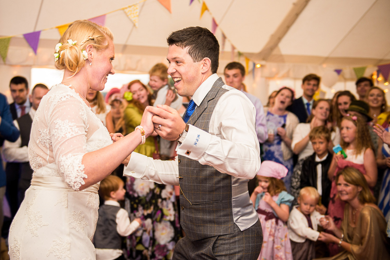 Copy of bride and groom doing their first dance at their marquee wedding