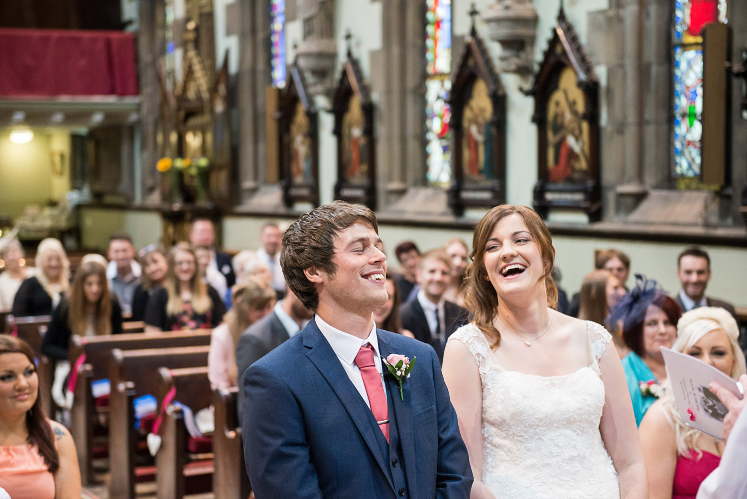 Copy of bride and groom laughing during the wedding ceremony in skipton