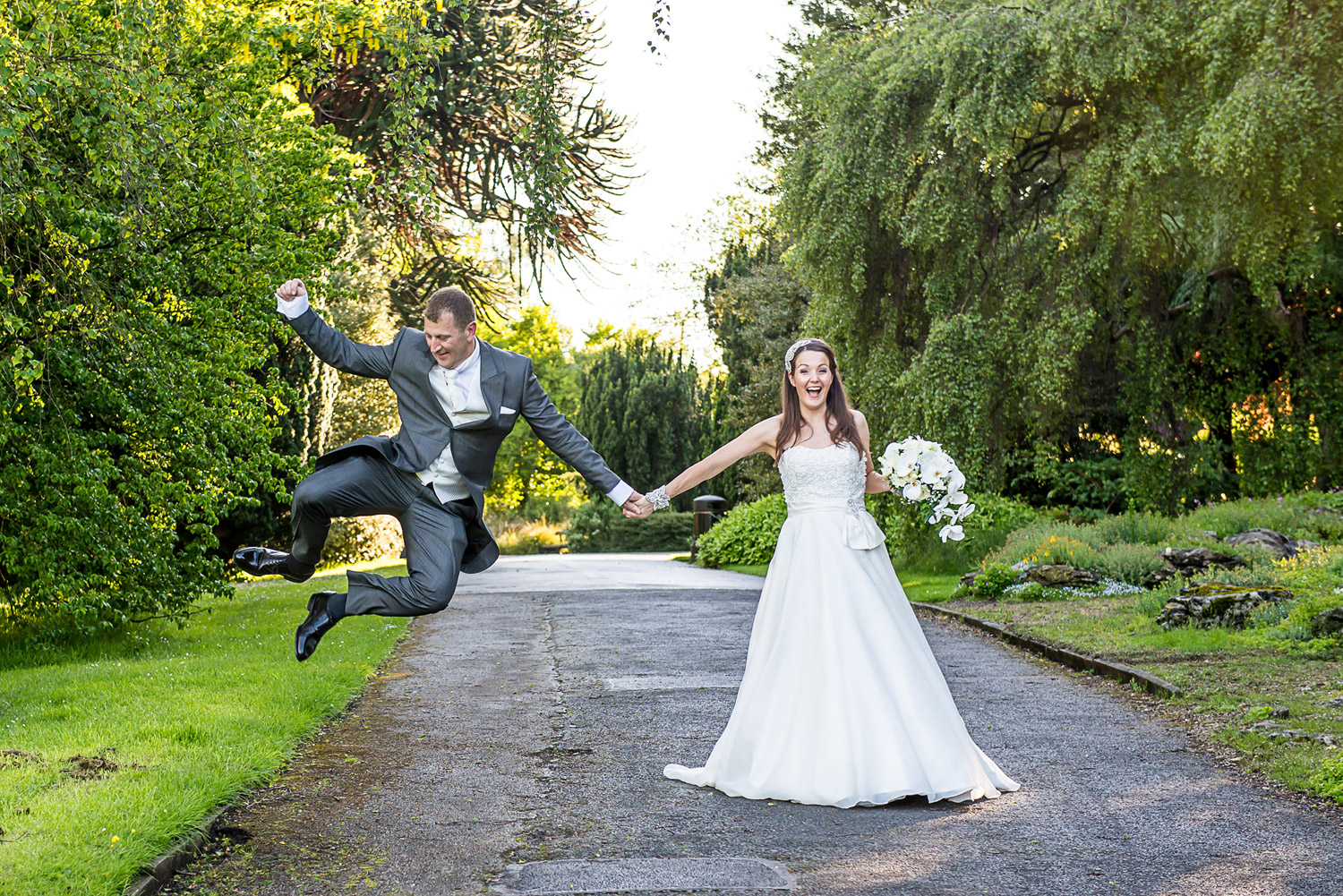 Copy of A Bride and Groom jumping in Valley Gardens, Harrogate