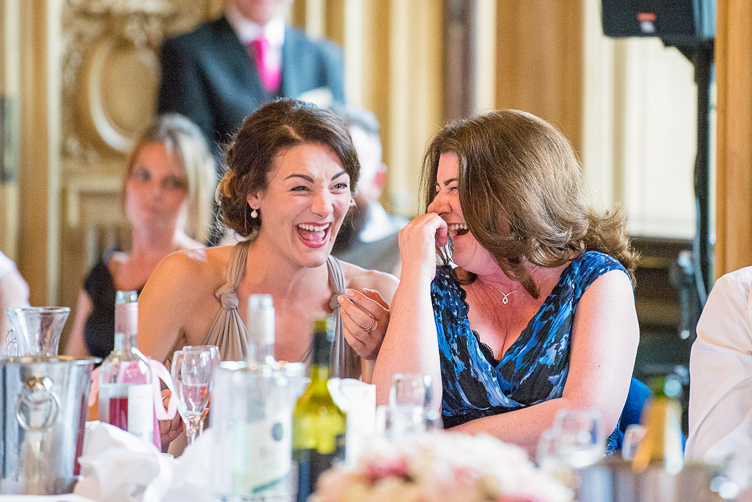 Copy of wedding guest laughing at best man's speech