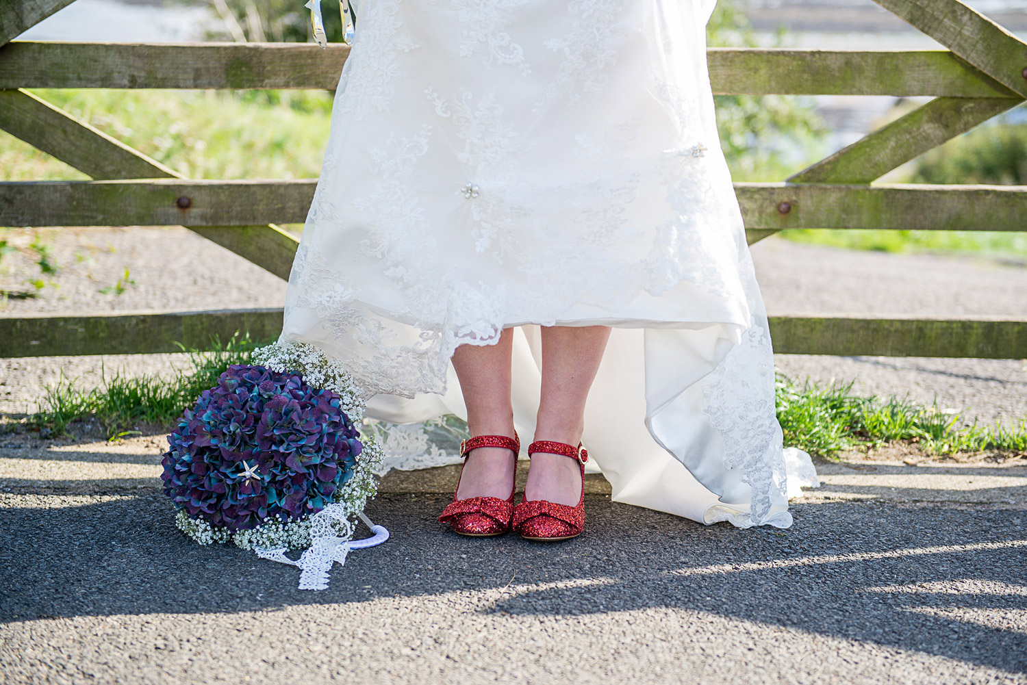Copy of photo of vintage red wedding shoes and flowers