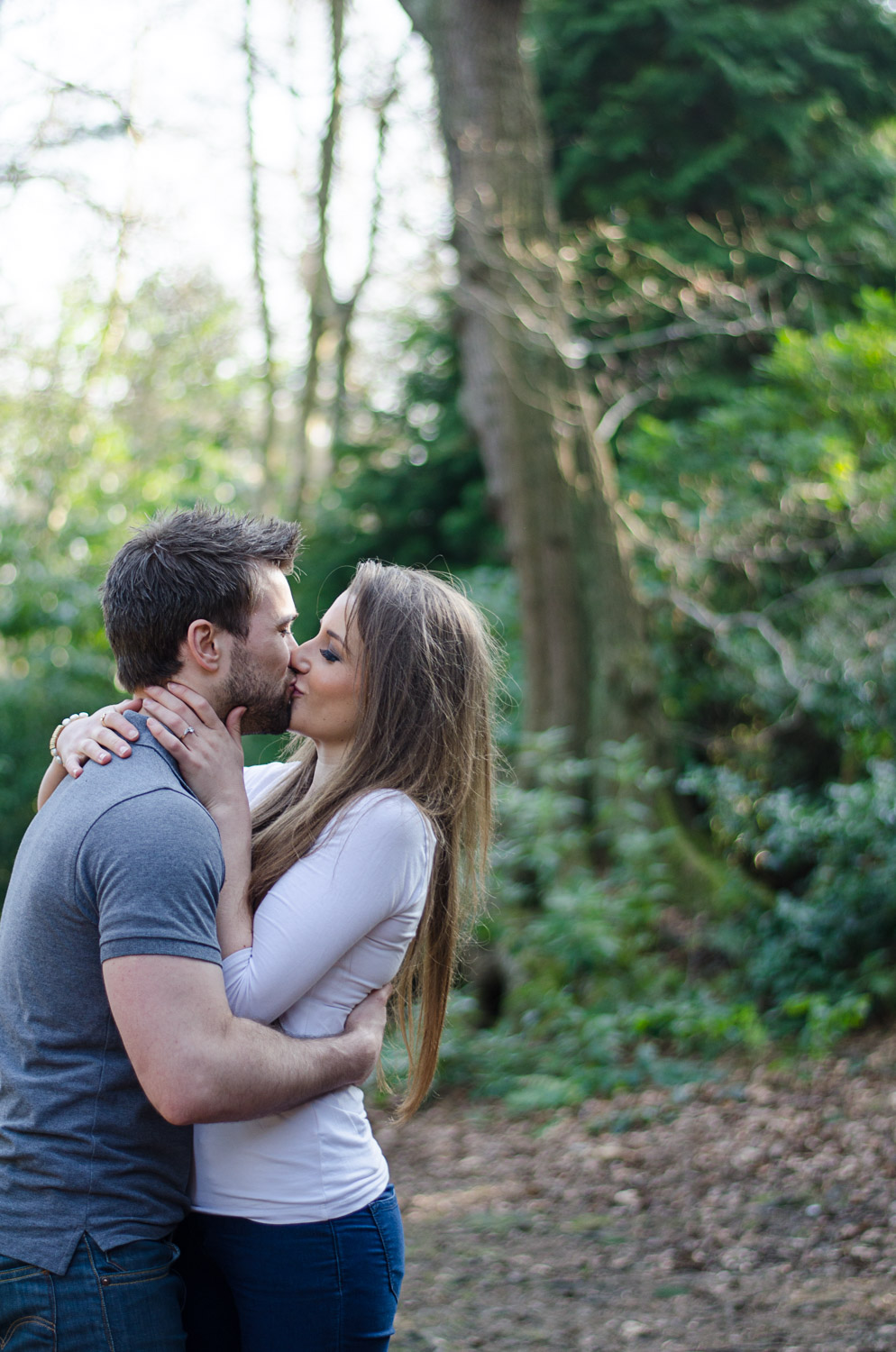 a couple kissing at golden hour in leeds wood