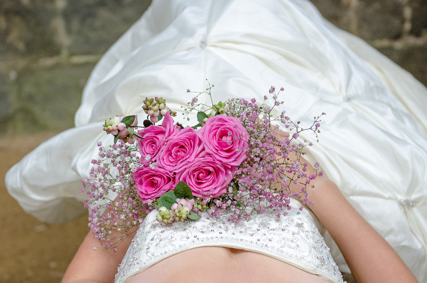 bride with pink wedding bouquet at kirkstall abbey