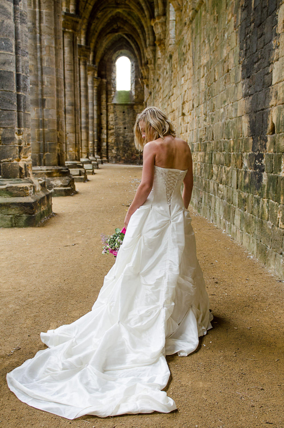 bride with dress train at kirkstall abbey