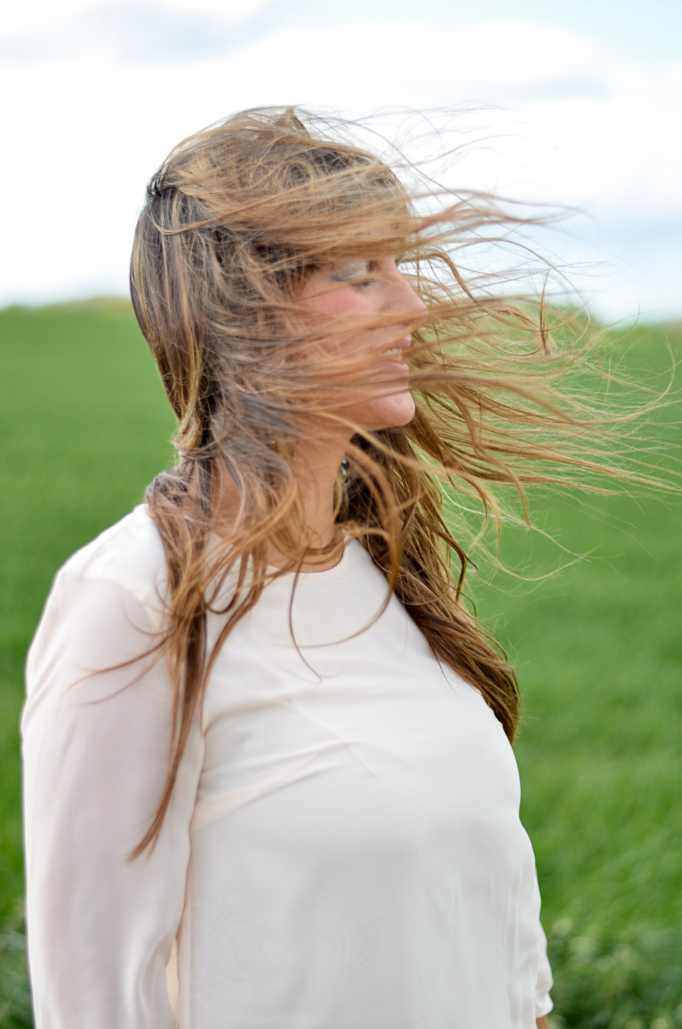 girl with her hair blowing in the wind
