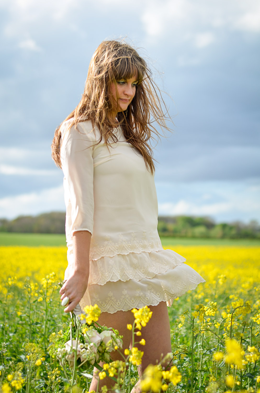 pontefract photo shoot of a girl in a field on yellow flowers