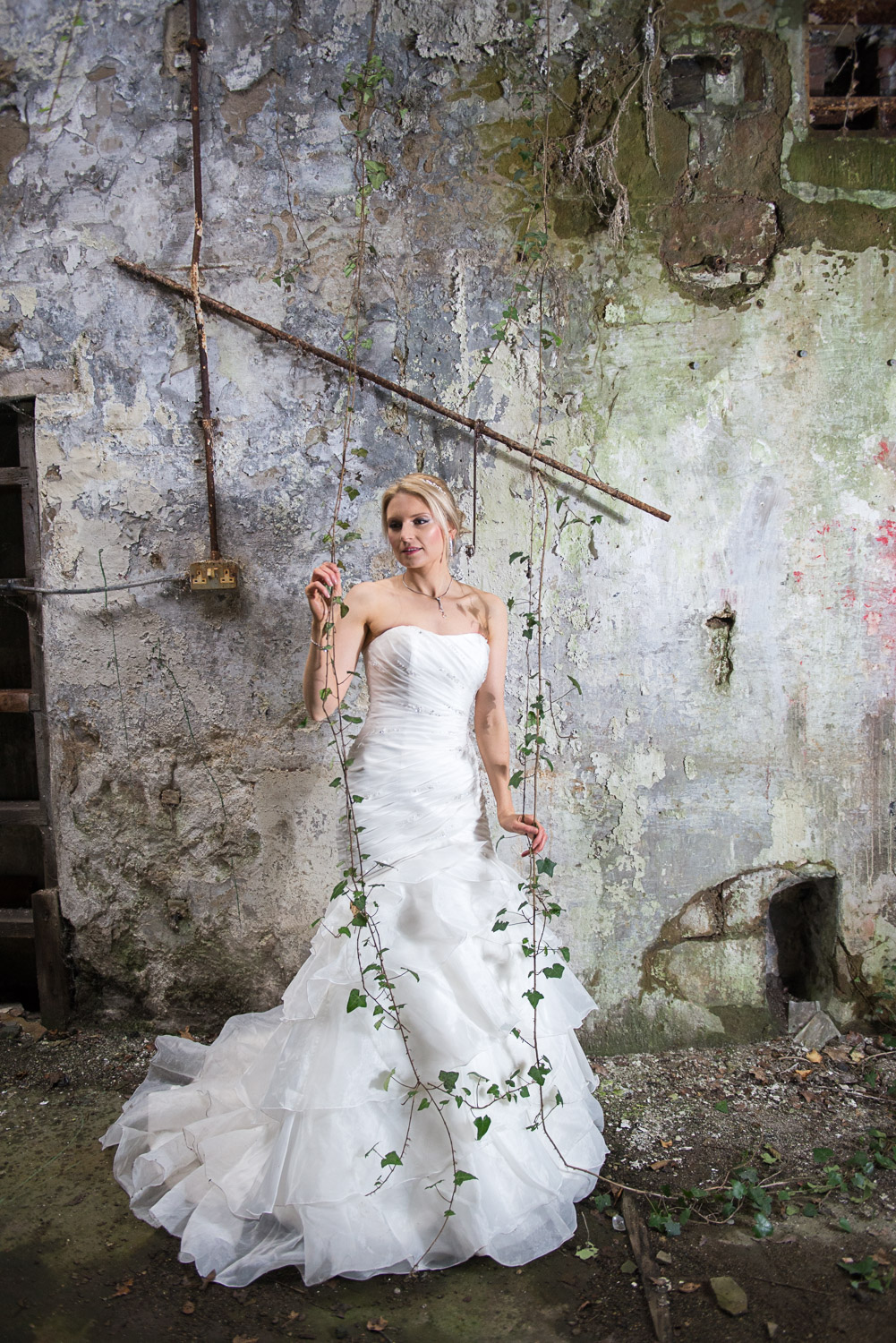 Styled photo shoot of a bride in an abandoned mill