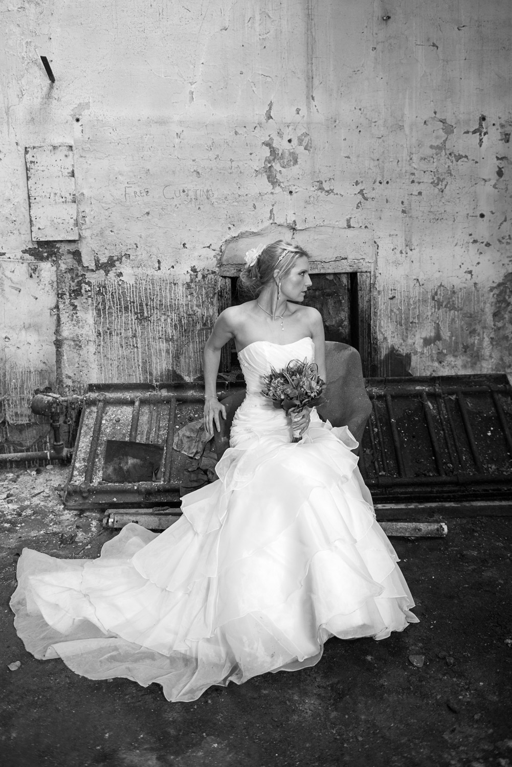 posed photo of a bride in an abandoned mill