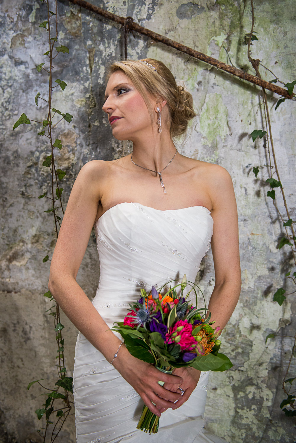 bride posed in an abandoned building in me