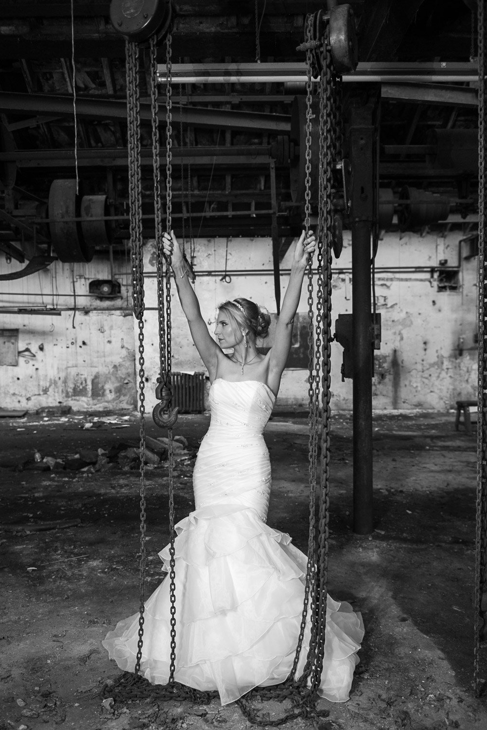dramatic posed bride in abandoned building