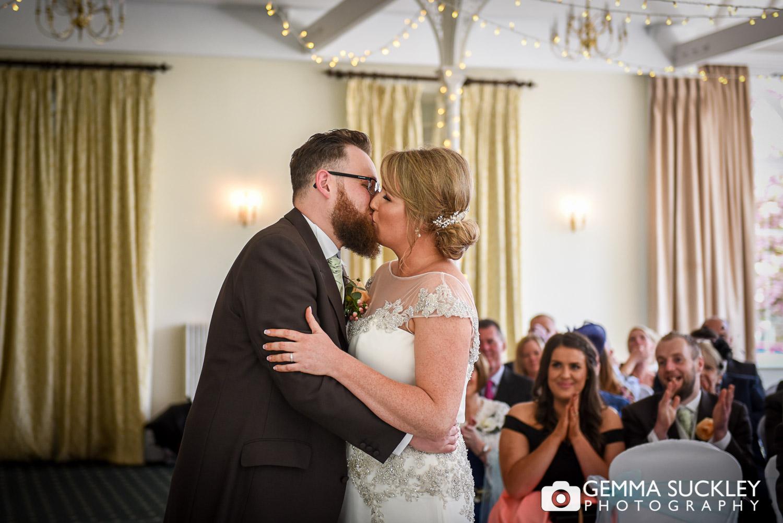 Groom kissing his bride at the Old Swan Hotel, Harrogate
