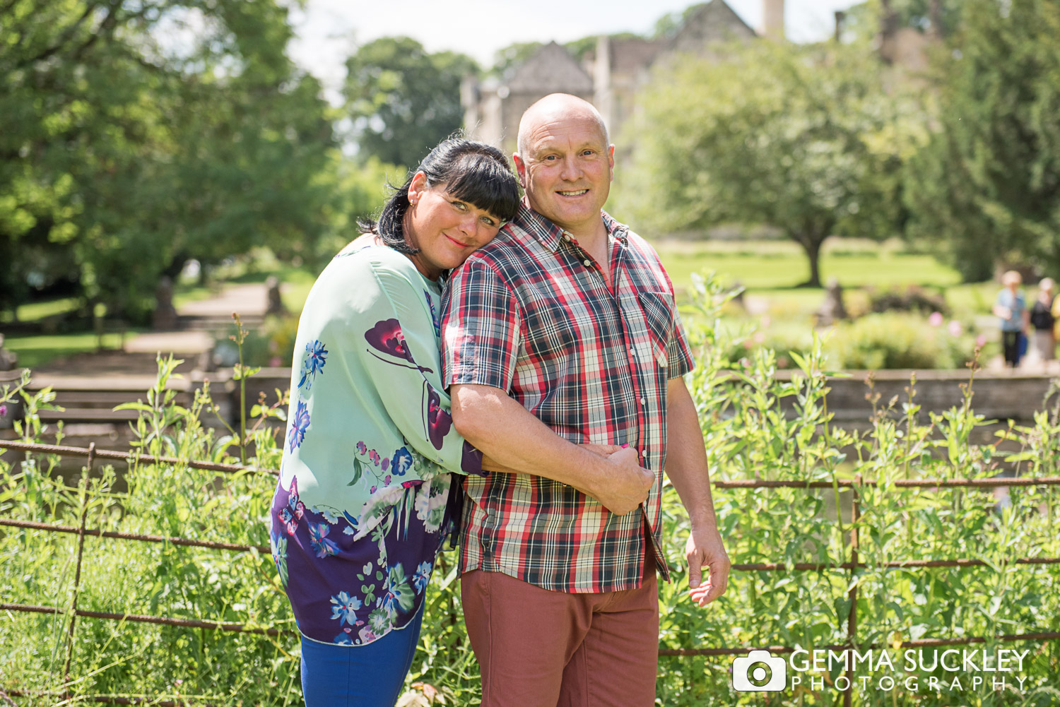 Couple smiling during their engagement photo shoot at Monk Fryston Hall