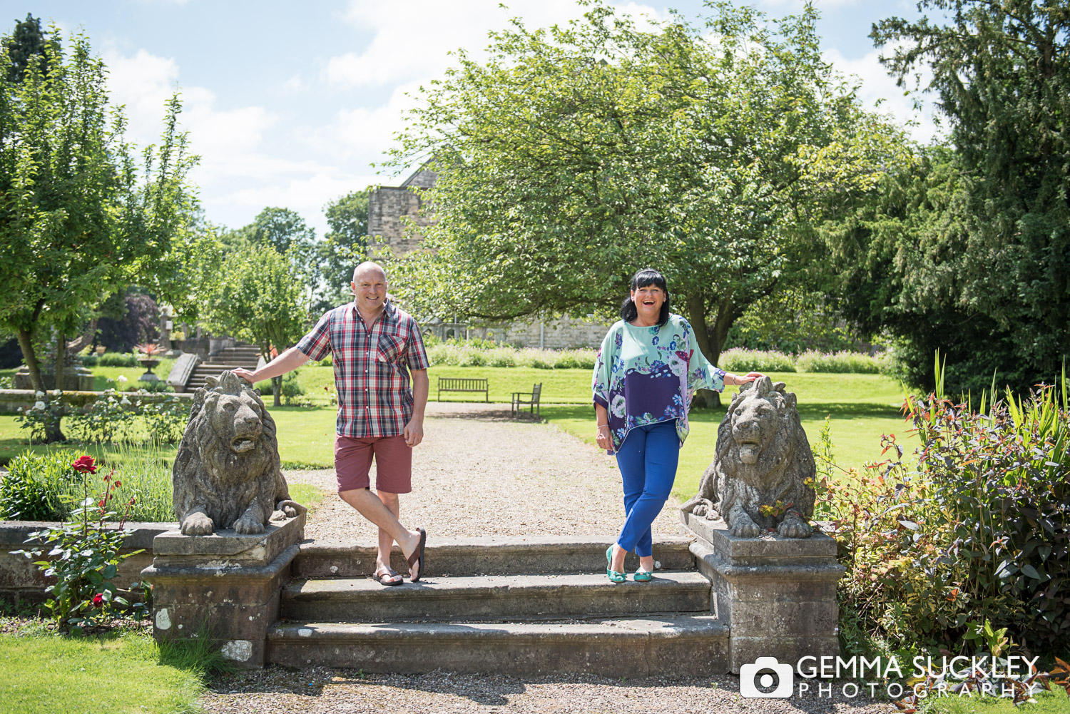 A couple in the gardens of Monk Fryston Hall on their pre-wedding photo shoot
