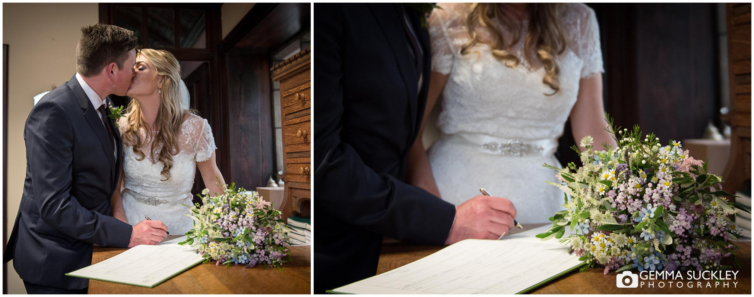 signing-the-register-wedding-photo©gemmasuckleyphotography.JPG