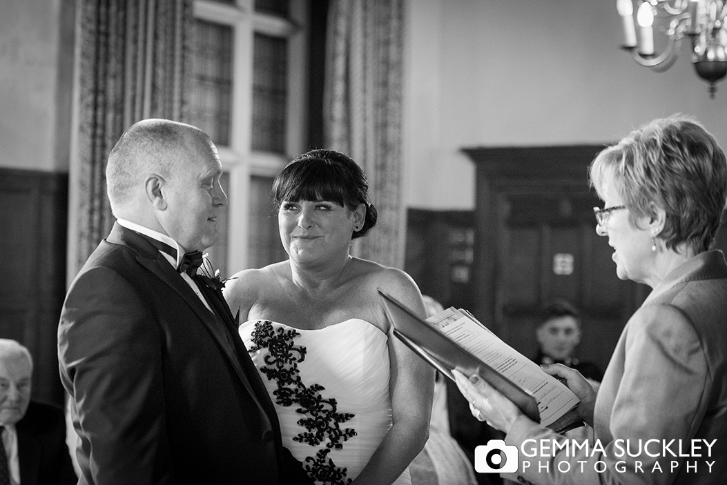 Bride and groom during their wedding ceremony at Monk Fryston Hall