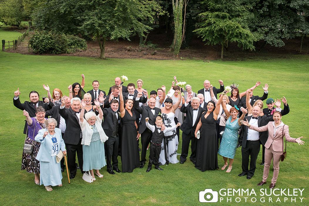 Group wedding photo in the gardens of Monk Fryston Hall