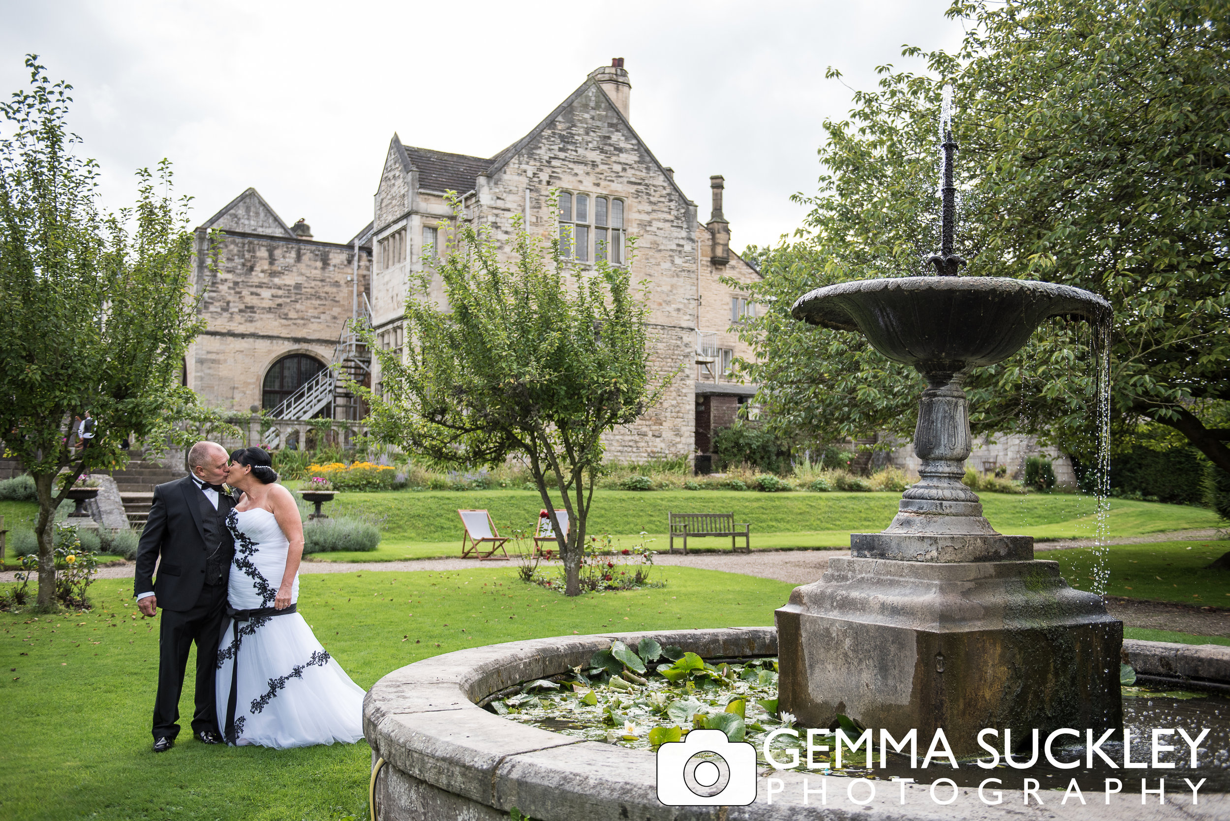 bride and groom kissing outside Monk Fyrston Hall on their wedding day