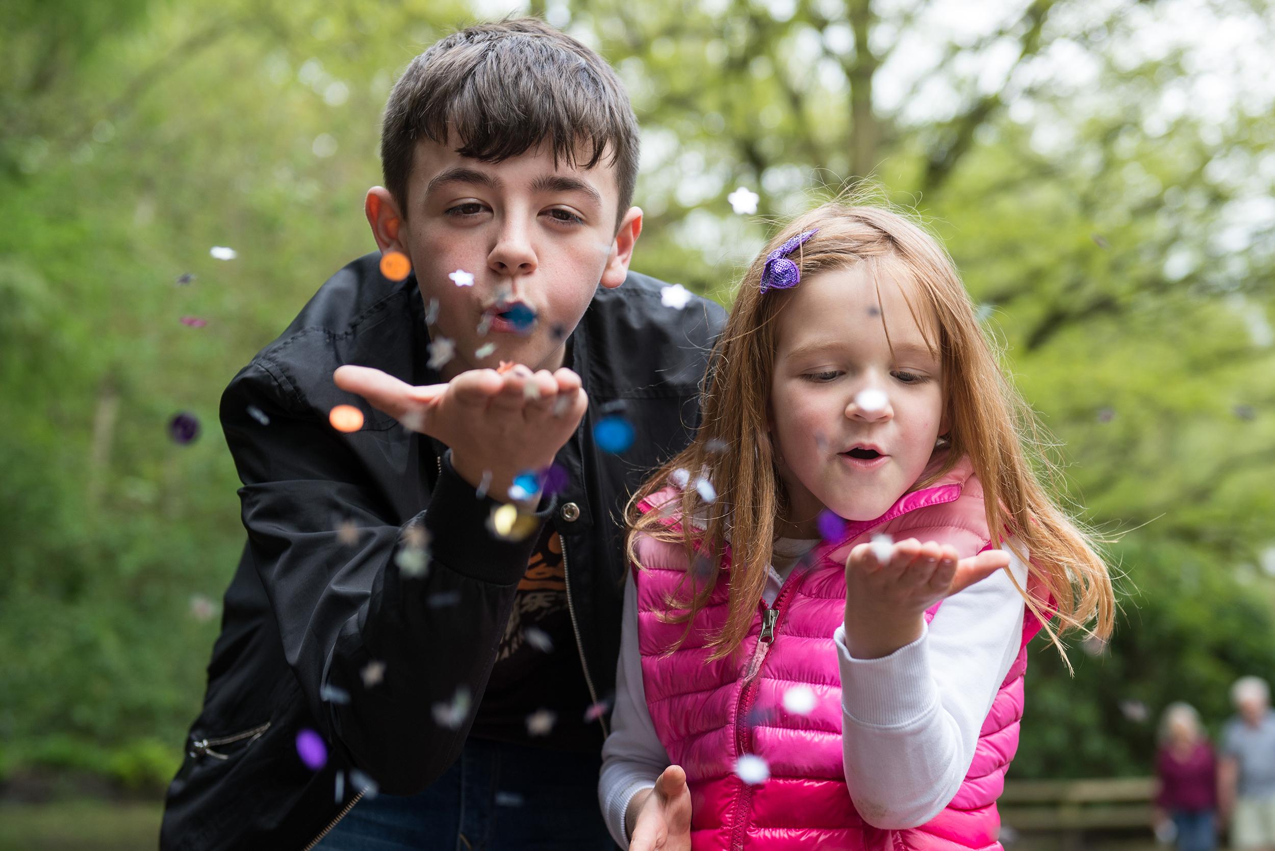 Copy of brother and siser blowing glitter in golden acre park