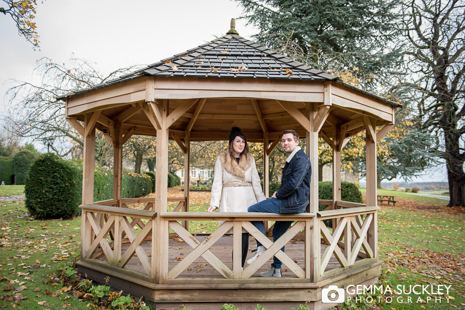 A couple smiling in a bandstand at Hazlewood castle
