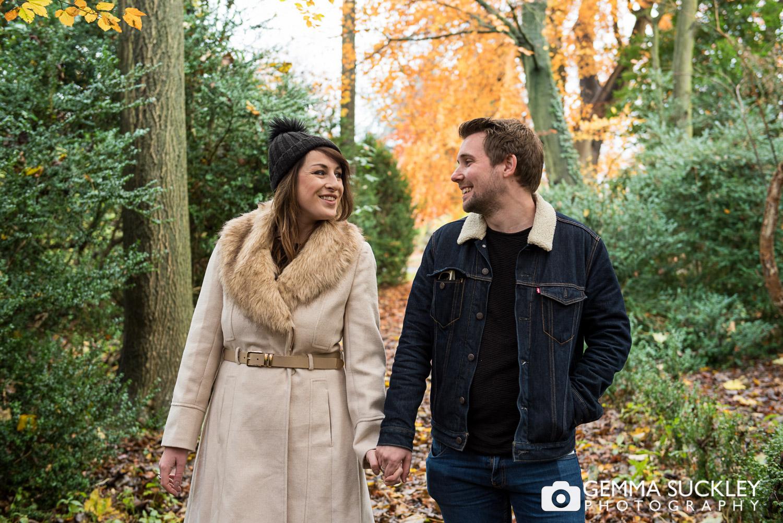 couple walking through a the gardens at Hazlewood Castle
