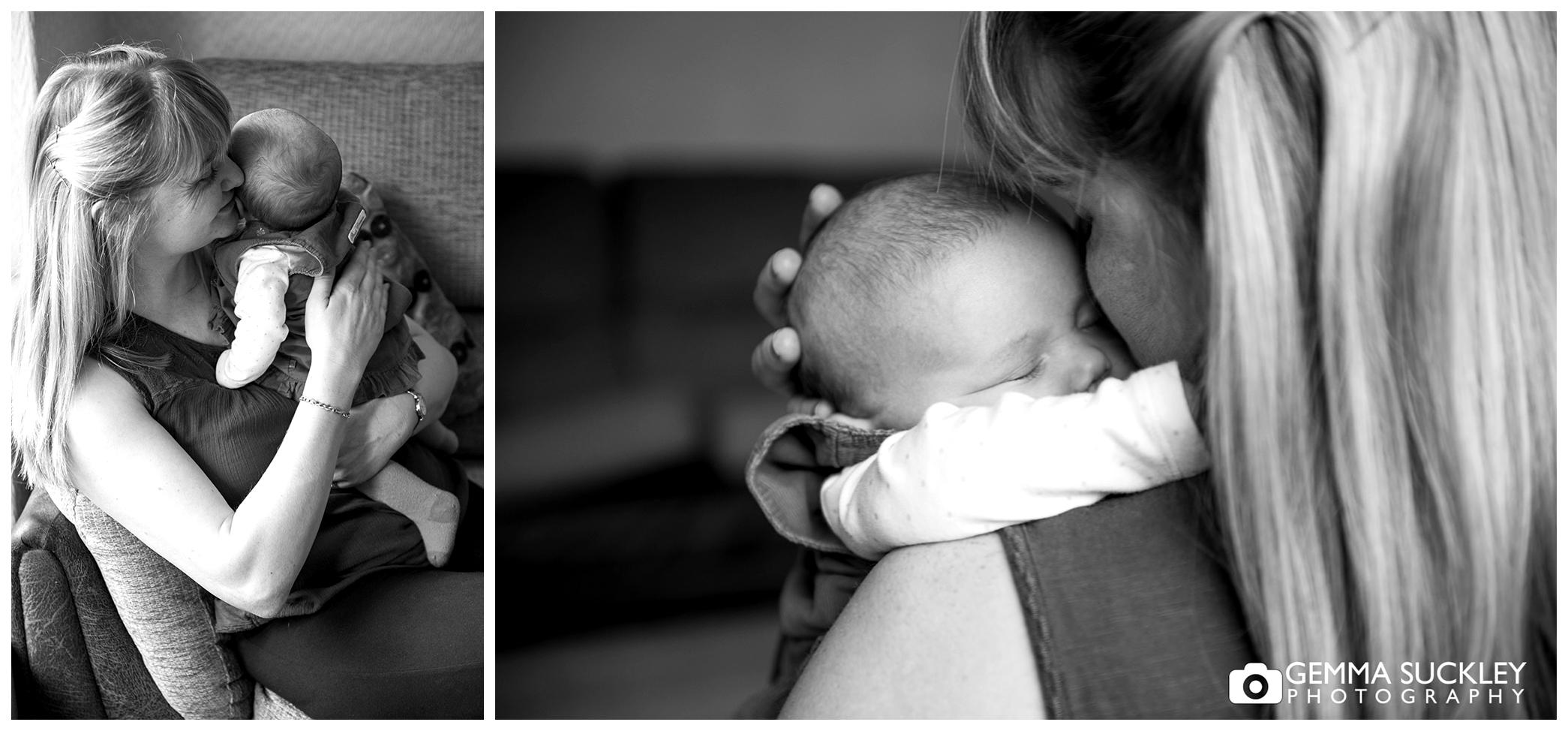 a mum cuddling her newborn baby
