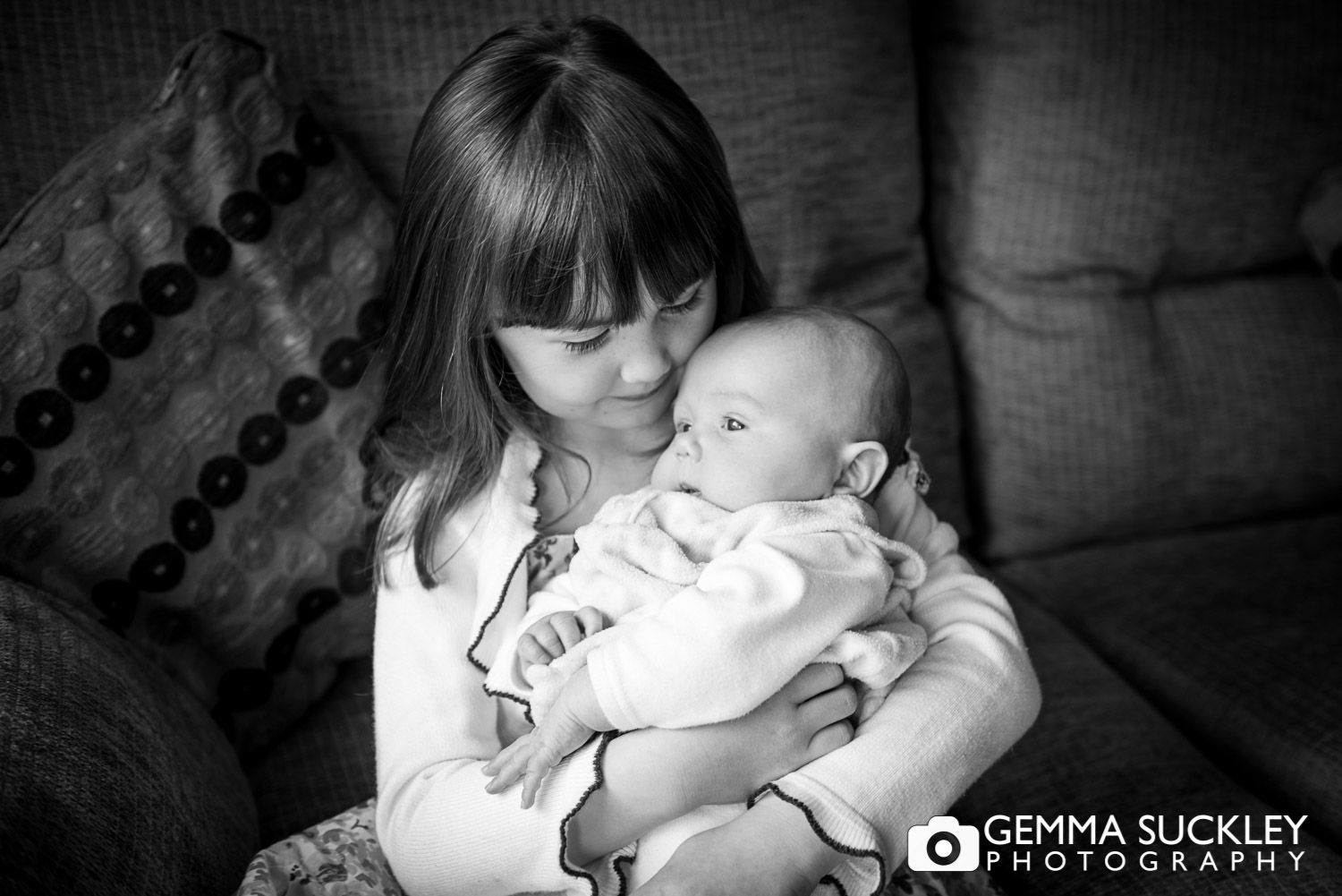 little girl and baby sister photo
