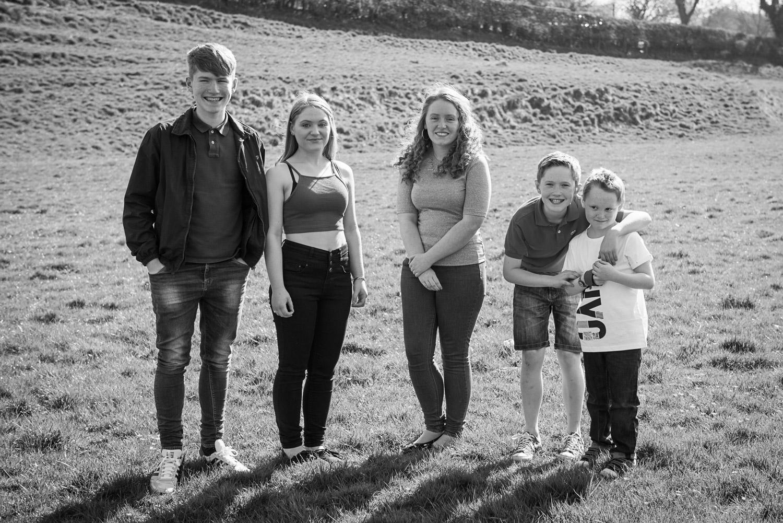 teenage kids smile for their photo