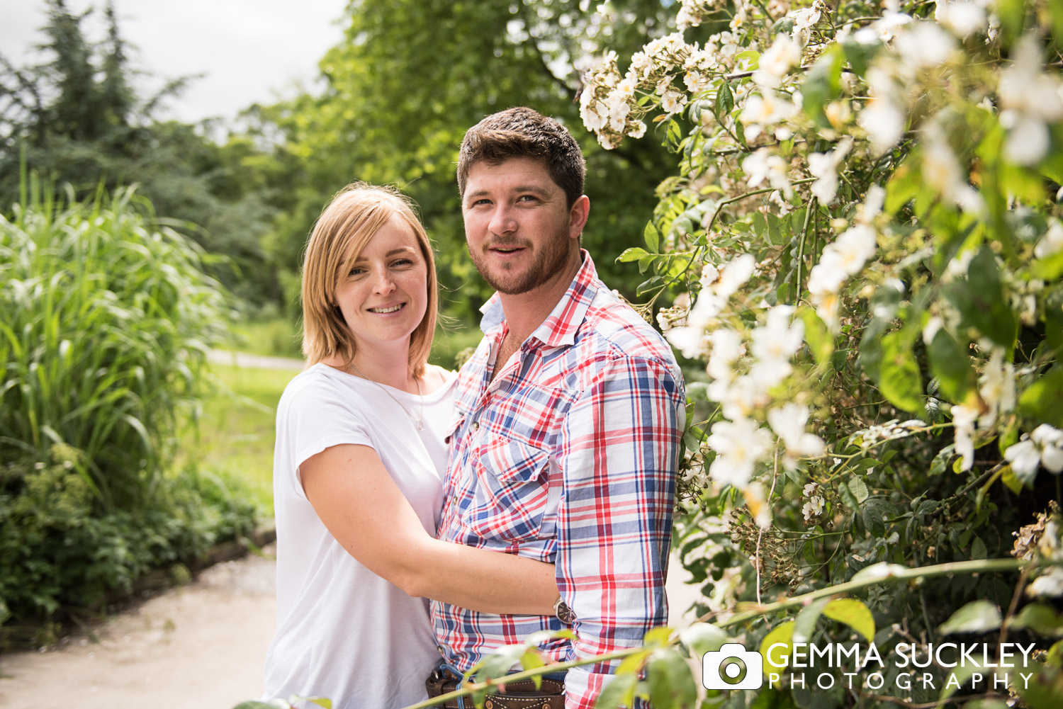 couple hugging at golden acre park on their engagement shoot