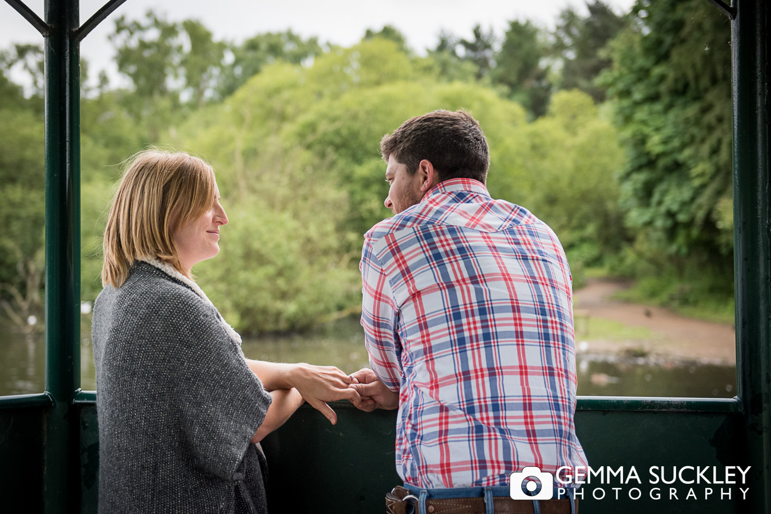 couple at Golden Acre park looking over the pond