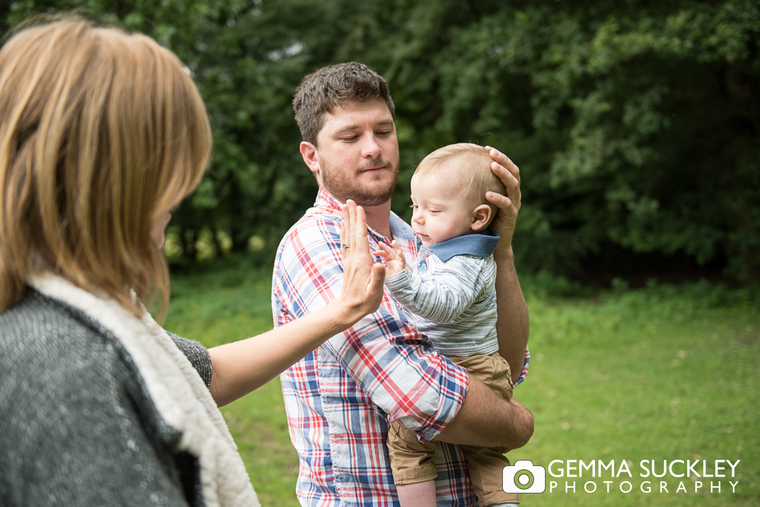 baby high five-ing during engagement shoot