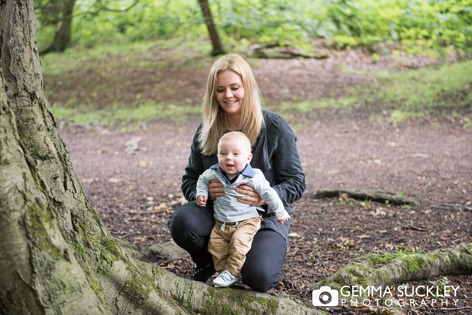 girl holding baby at golden acre park