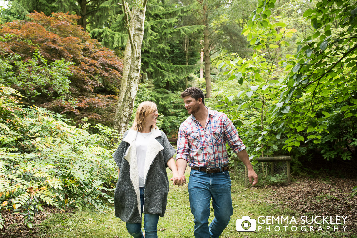 engagement shoot with couple holding hands at Golden Acre Park