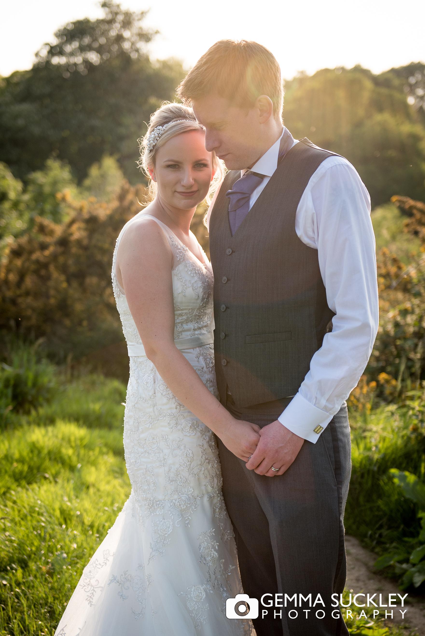 bride and groom on ilkley moor during golden hour