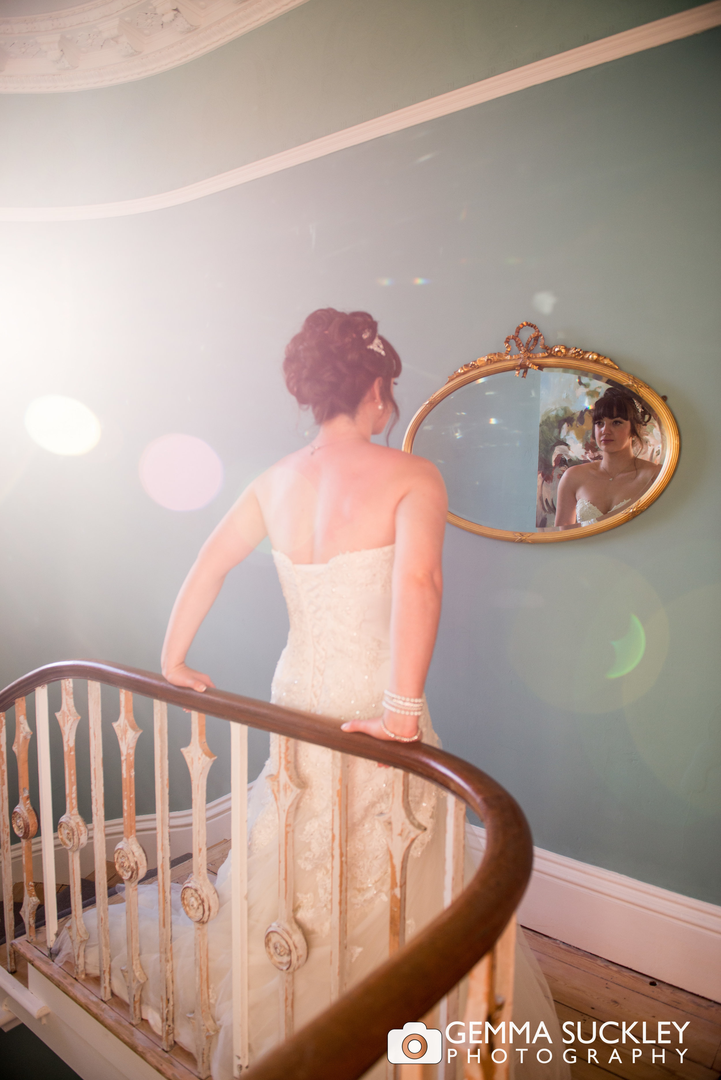 Bride looking in the mirror at taitlands