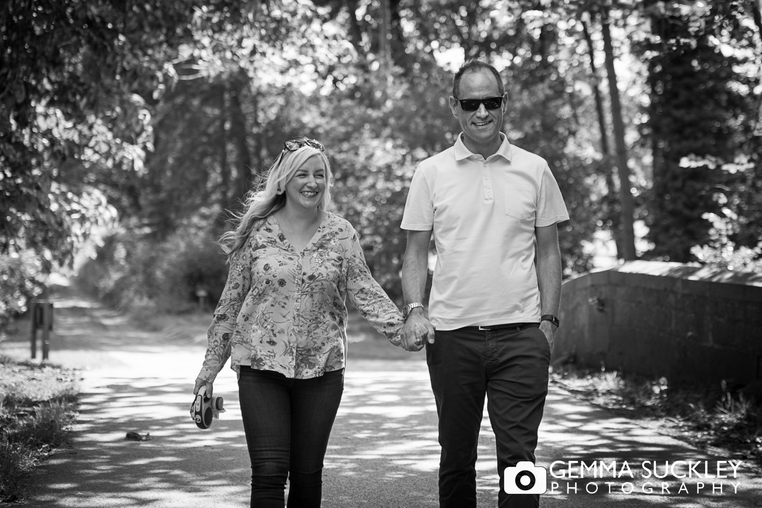 couple walking hand in hand during their engagement shoot in leeds