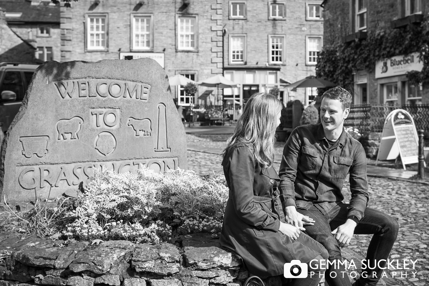 Couple holding hands in Grassington village square